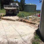 Truck preparing pad for tank installation